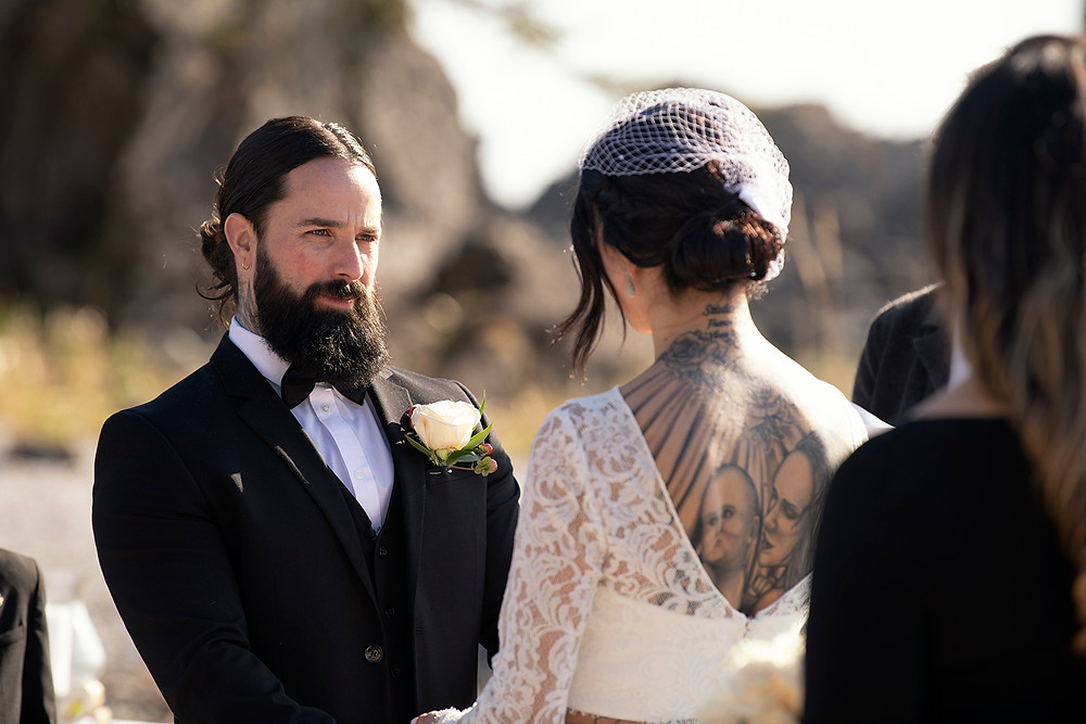 Groom looks at his bride lovingly at their Ucluelet Elopement. Photographed by Kaitlyn Shea.