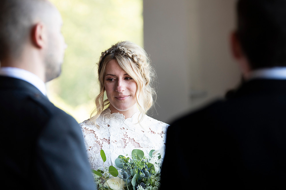 Beautiful bride at wedding ceremony at Sea Cider in Victoria. Photographed by Kaitlyn Shea.