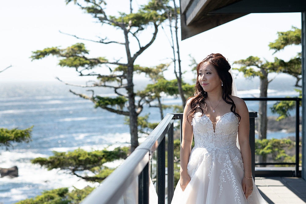 Bride stands on her patio at a Ucluelet wedding at Black Rock Resort. Photographed by Ucluelet Photographer Kaitlyn Shea.
