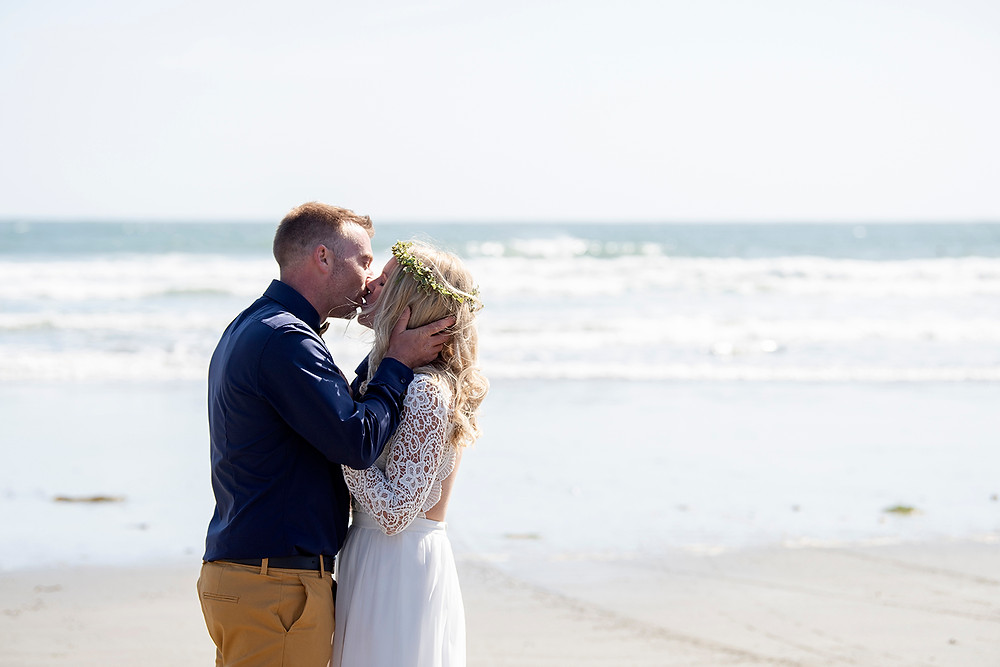 the kiss at Tofino wedding. Photographed by Kaitlyn Shea