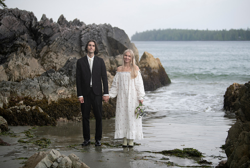 Couple smiles at their Tonfino wedding at Tonquin Beach. Photographed by Tofino wedding photographer Kaitlyn Shea.
