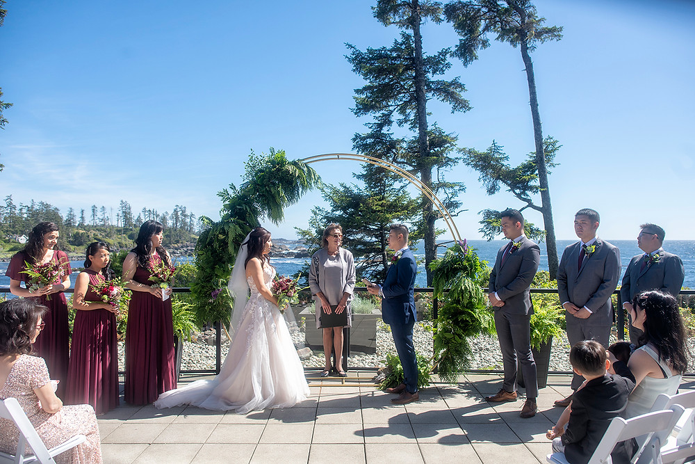 Couple reads vows at their Ucluelet wedding at Black Rock Resort. Photographed by Ucluelet Photographer Kaitlyn Shea.