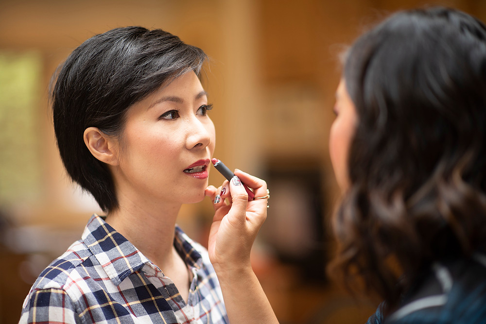 bride getting her makeup done at destination wedding in Tofino. Photographed by Kaitlyn Shea.