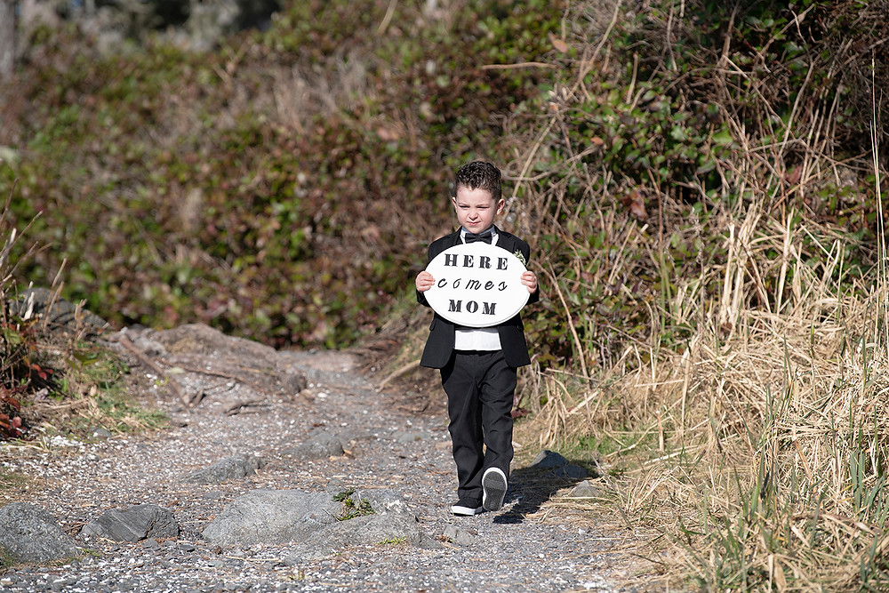 Bride and groom's second son walks down aisle while they are eloping in Ucluelet. Photographed by Kaitlyn Shea.