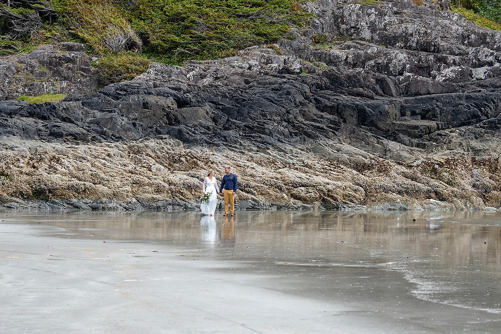wedding photo on Chesterman Beach Tofino. Photographed by Kaitlyn Shea