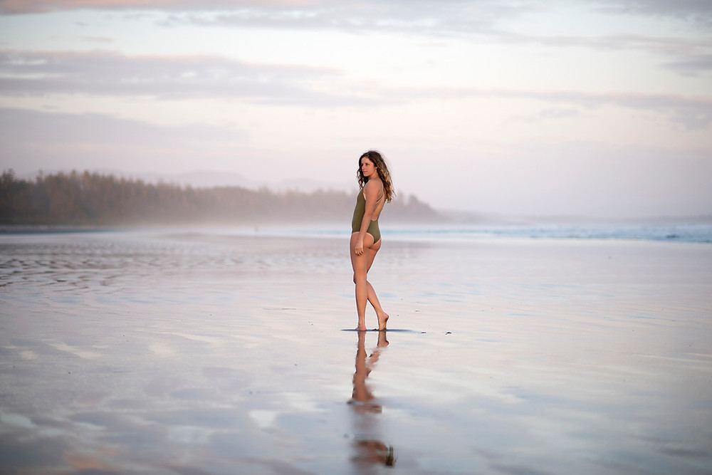 Girl poses in Monaia swimsuit at sunset on Long Beach in Tofino. Photographed by Kaitlyn Shea.