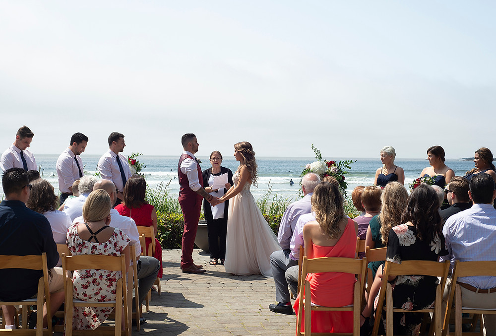 receiting vows during ceremony at Long Beach Lodge wedding in tofino. Photographed by Kaitlyn Shea