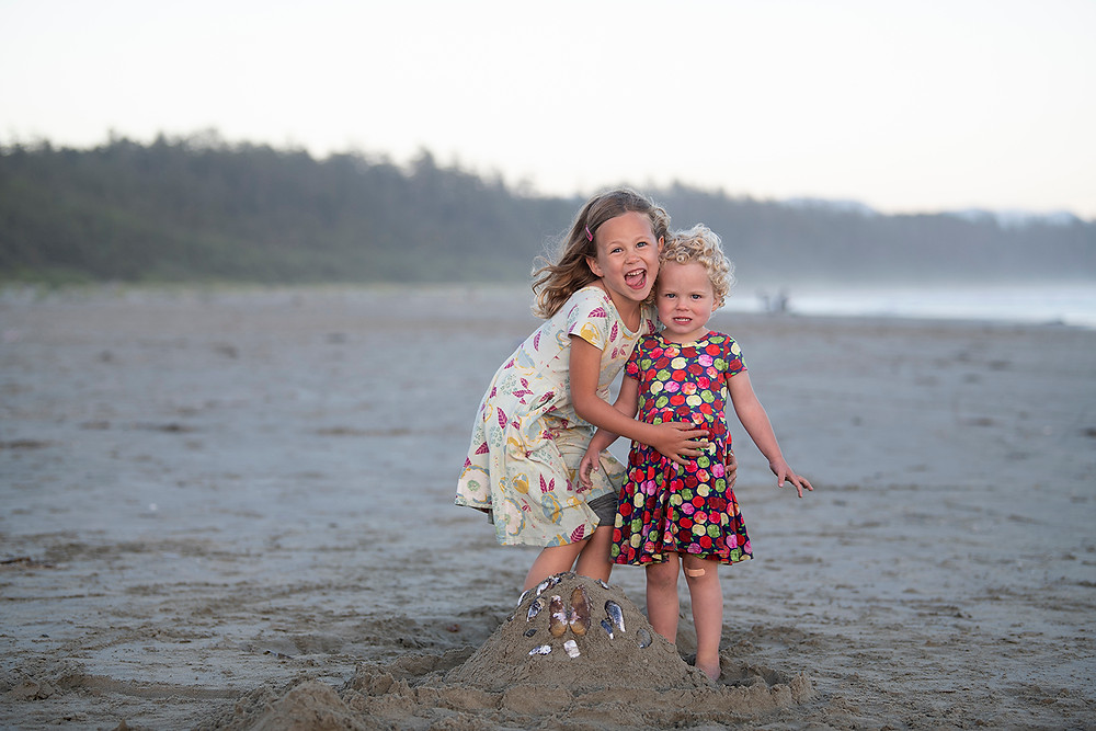 Family on Long Beach in Tofino. Photographed by Kaitlyn Shea.