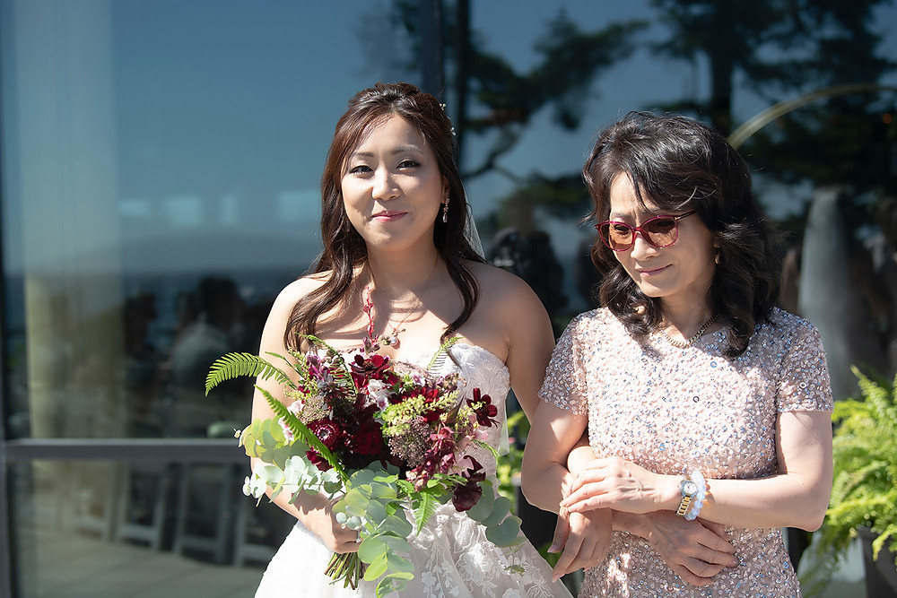 Bride walks down the aisle with her mom at her Ucluelet wedding at Black Rock Resort. Photographed by Ucluelet Photographer Kaitlyn Shea.