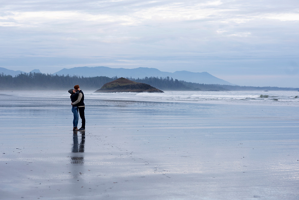 Couple kisses during their engagement photos in Tofino. Photographed by Kaitlyn Shea.