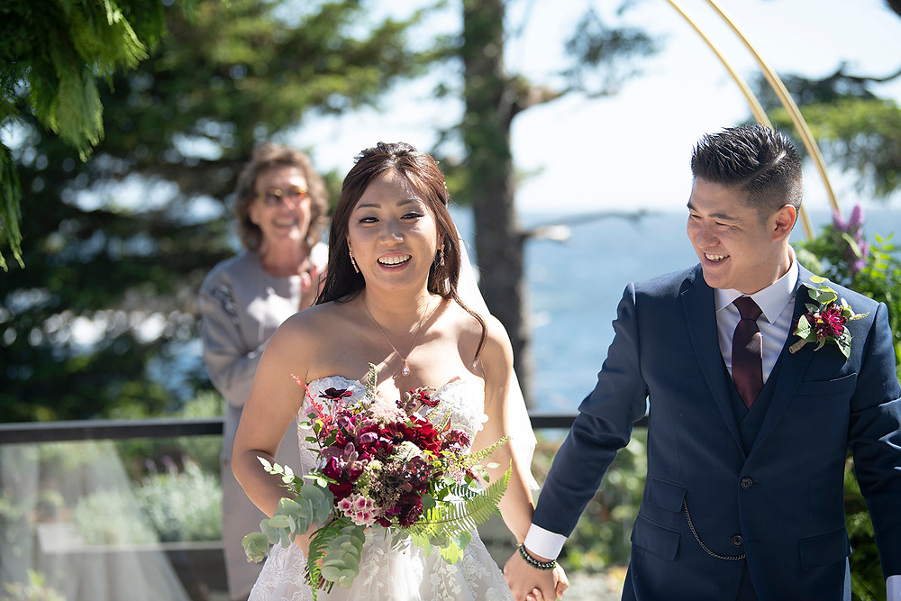 Newly married couple smiles at their Ucluelet wedding at Black Rock Resort. Photographed by Ucluelet Photographer Kaitlyn Shea.