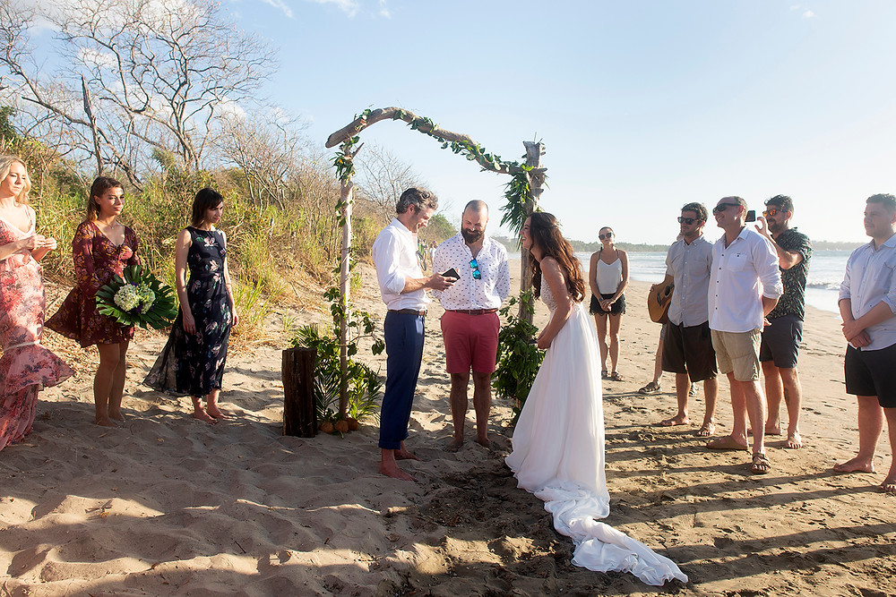 Bride laughs at groom at their destination wedding in Playa Grande. Photographed by Kaitlyn Shea.