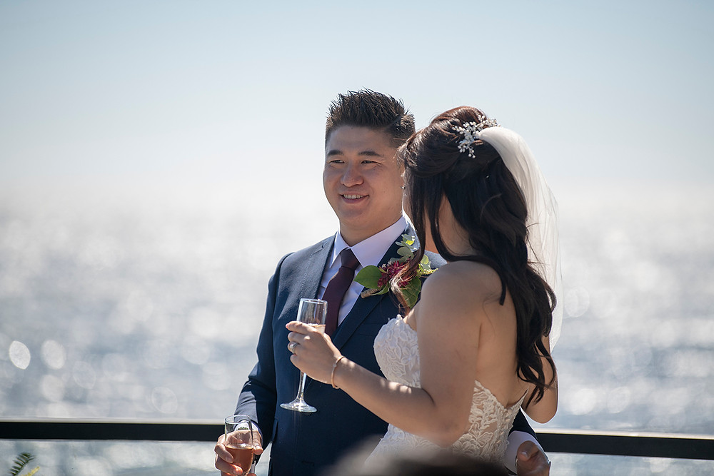 Groom sips champagne after ceremony at his Ucluelet wedding at Black Rock Resort. Photographed by Ucluelet Photographer Kaitlyn Shea.