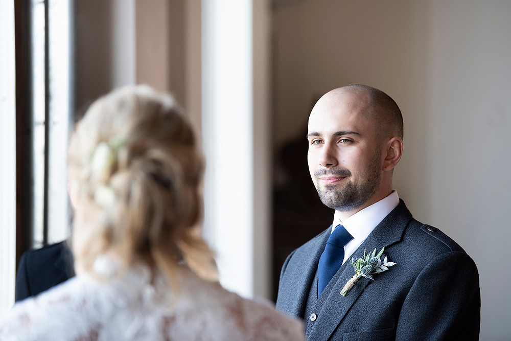 Groom smiles at bride during Sea Cider wedding ceremony in Victoria. Photographed by Kaitlyn Shea.
