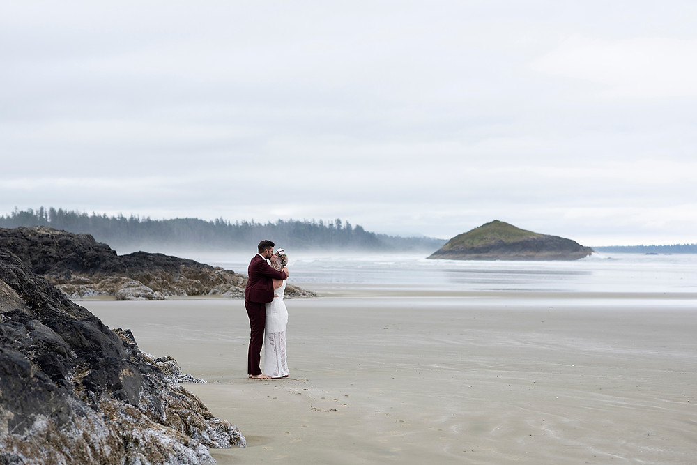 Couple renews their wedding vows on Long Beach in tOFINO. photographed by Kaitlyn Shea.