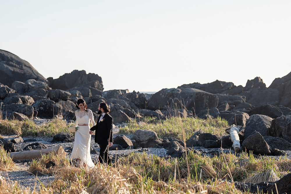Lovers in nature at their elopement in Ucluelet. Photographed by Kaitlyn Shea.