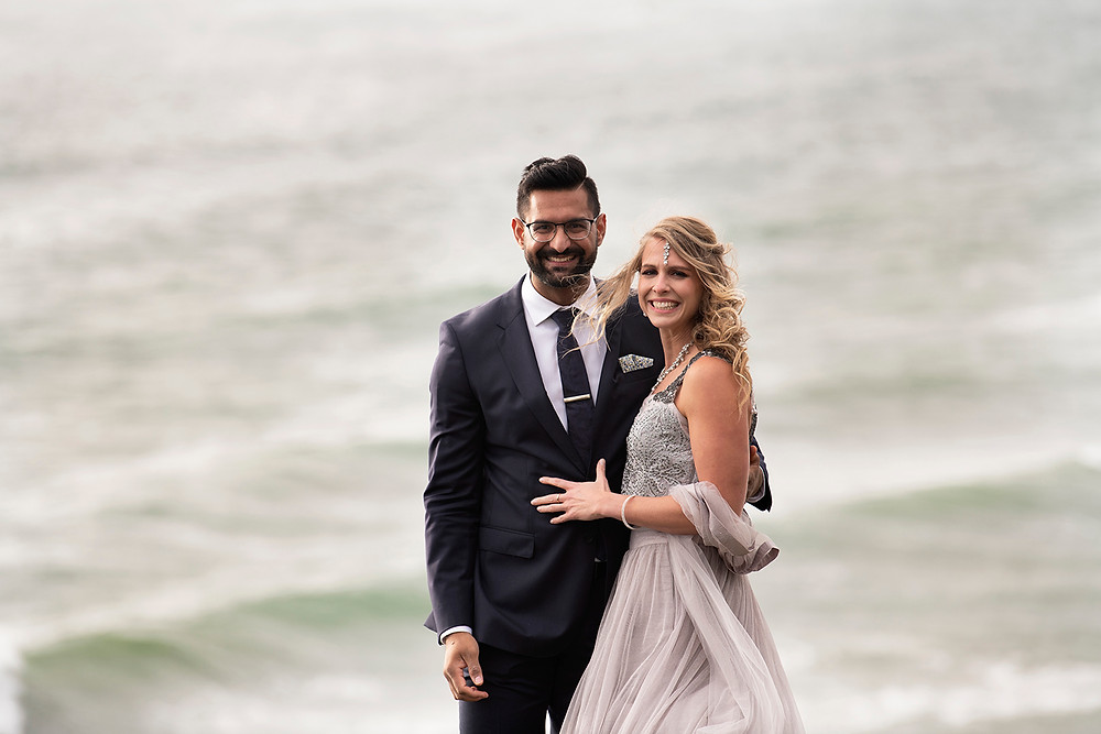 Bride smiles while holding her husband at their small wedding in Tofino. Photographed by Tofino wedding photographer Kaitlyn Shea.