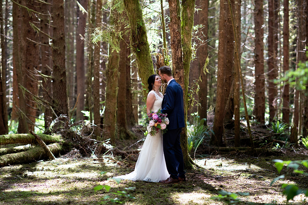 Forest wedding ceremony in Tofino. Photographed by Kaitlyn Shea.