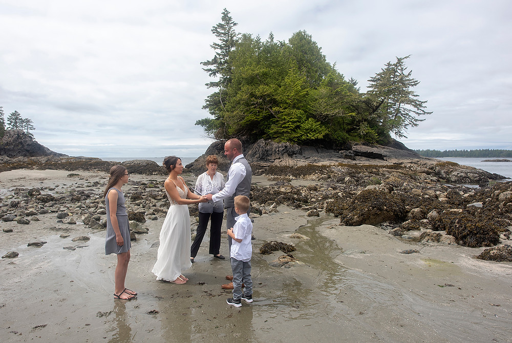Beach wedding ceremony at an at elopement in Tofino. Photographed by Kaitlyn Shea.