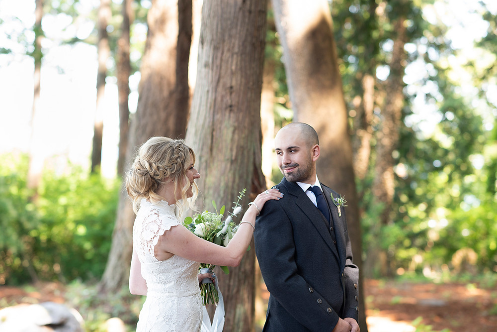 groom sees bride for the first time at their Sea Cider wedding on Vancouver Island. Photographed by Kaitlyn Shea.