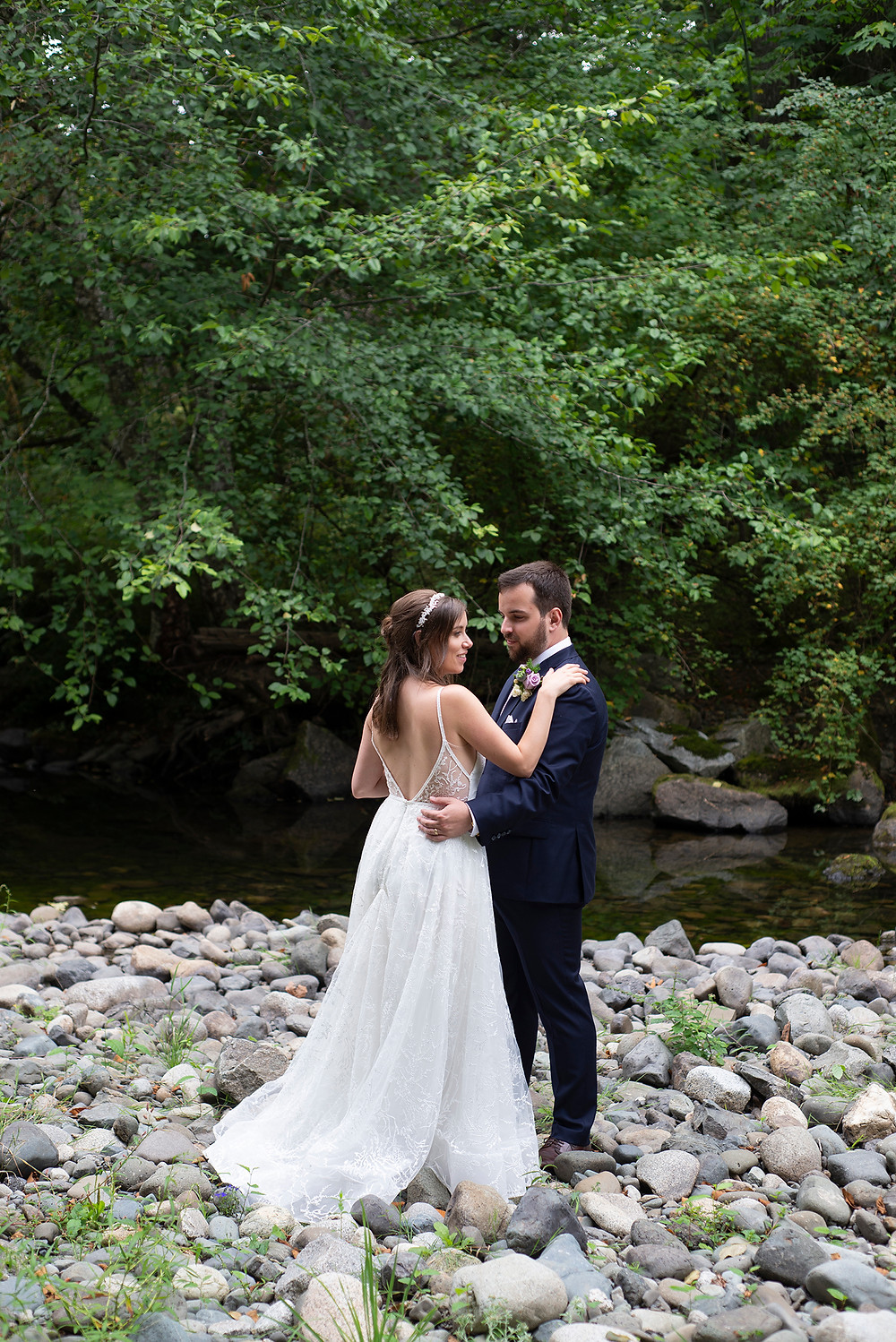 Bride shows off her beautiful wedding dress at her August wedding on Vancouver Island. Photographed by Kaitlyn Shea.