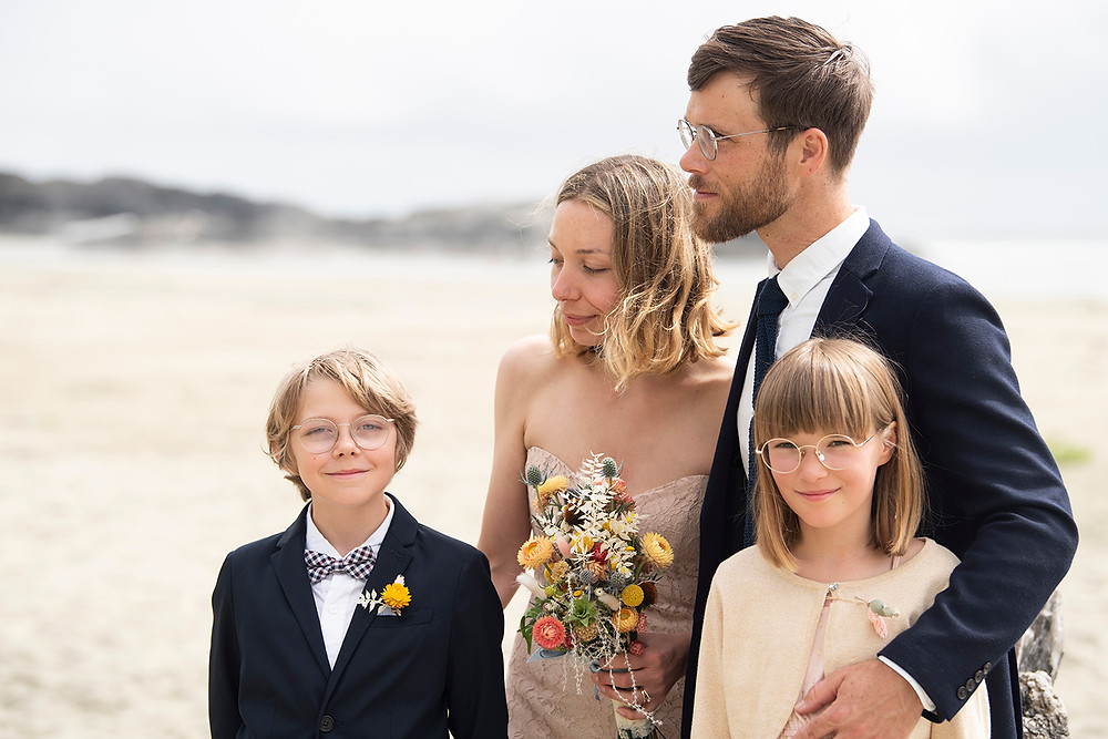 Bride and groom and their children at Tofino beach elopment. Photographed by Kaitlyn Shea.