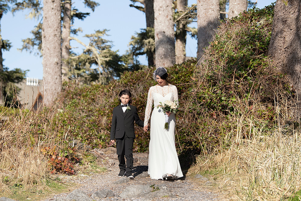 Bride makes her grand entrance while eloping in Ucluelet. Photographed by Kaitlyn Shea.