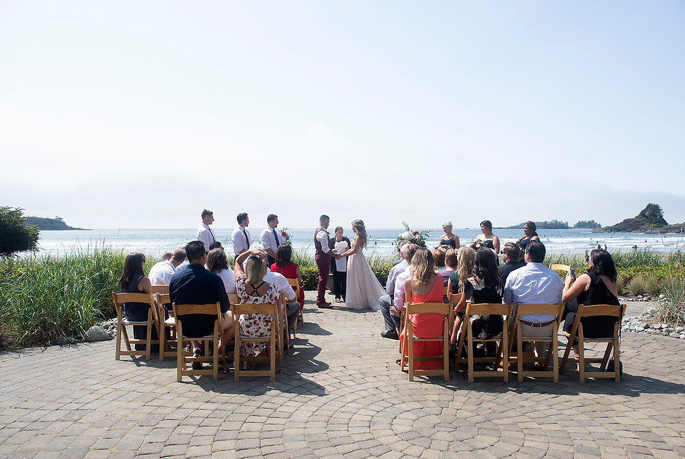 wedding ceremony on the beach at Cox Bay Tofino. Photographed by Kaitlyn Shea