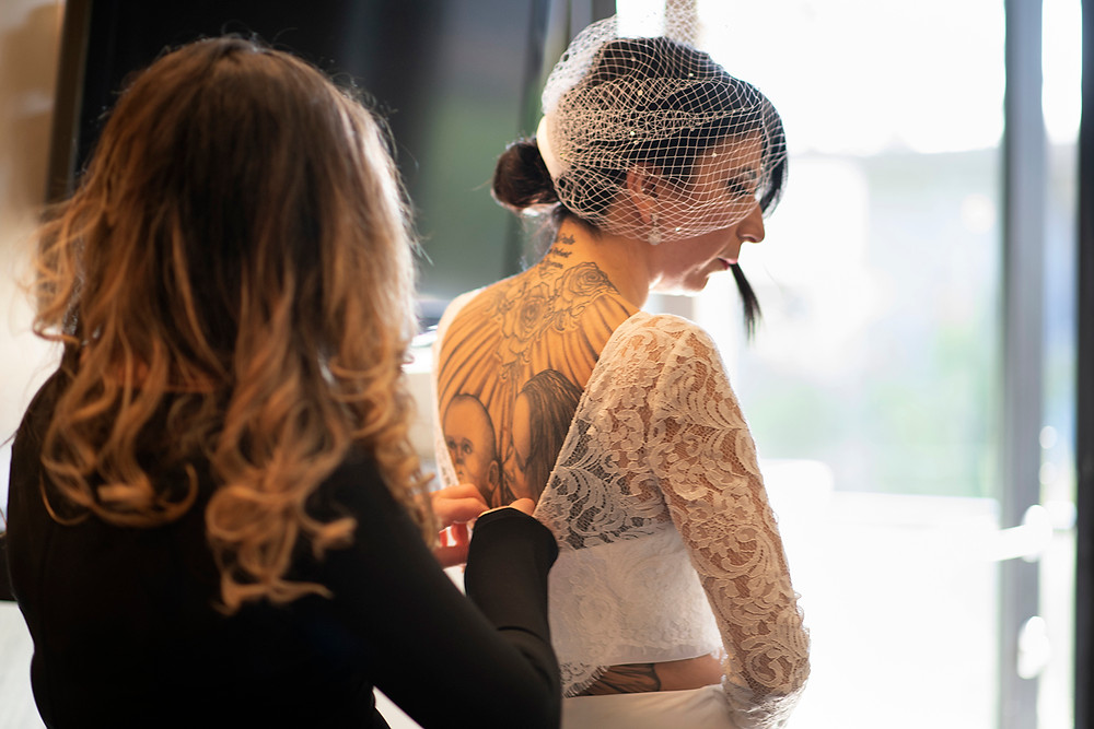 Bride gets helped with her dress at her Ucluelet Elopement