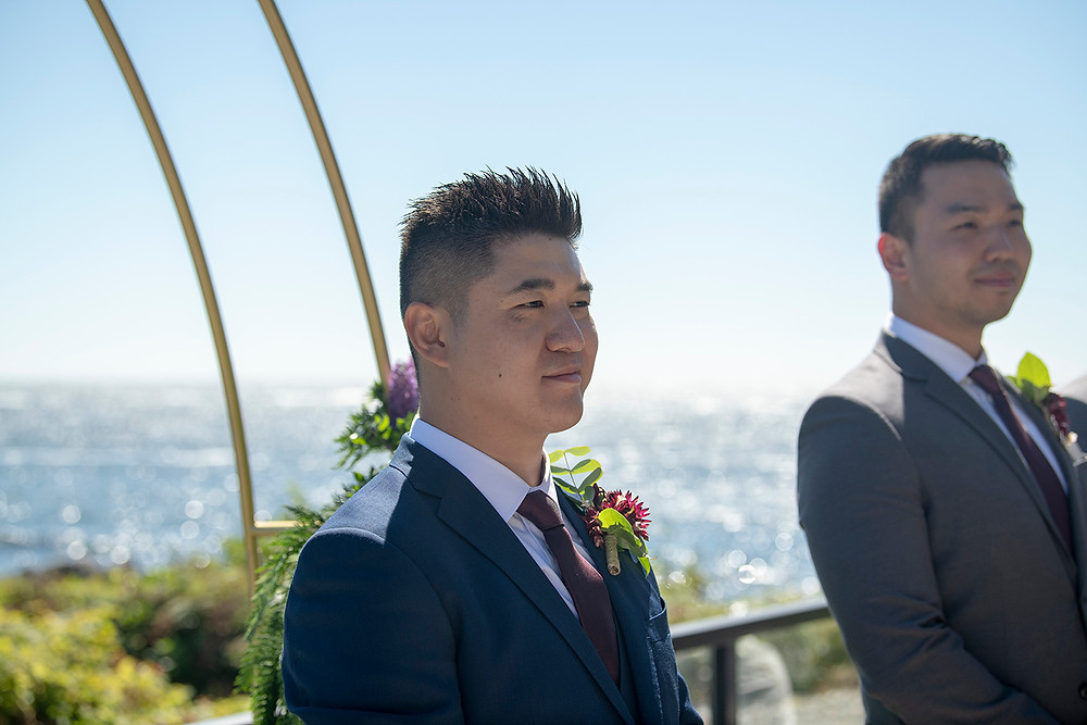 Groom sees bride for the first time at a Ucluelet wedding at Black Rock Resort. Photographed by Ucluelet Photographer Kaitlyn Shea.