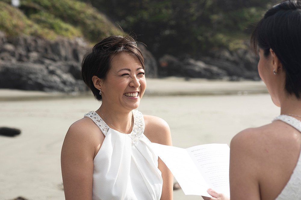 reciting vows at destination wedding in Tofino. Photographed by Kaitlyn Shea.