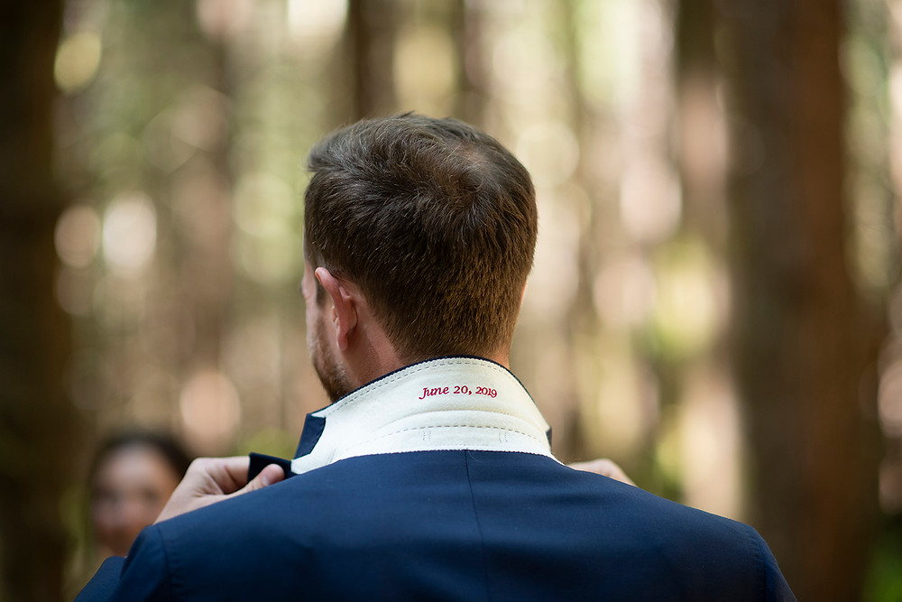 Groom's suit jacket at a forest wedding in tofino. Photographed by Kaitlyn Shea.