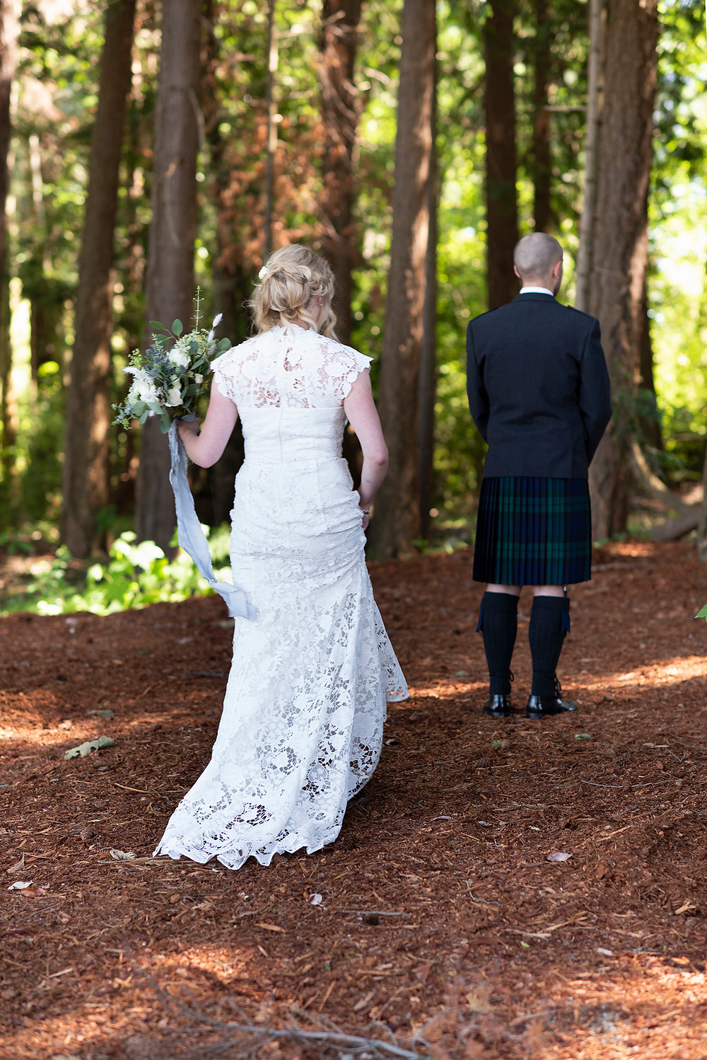 The first look in the forest at Sea Cider wedding in Victoria. Photographed by Tofino photographer Kaitlyn Shea.