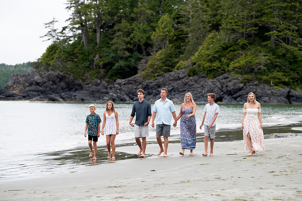 Family walks down Middle Beach in Tofino. Photographed by Kaitlyn Shea.