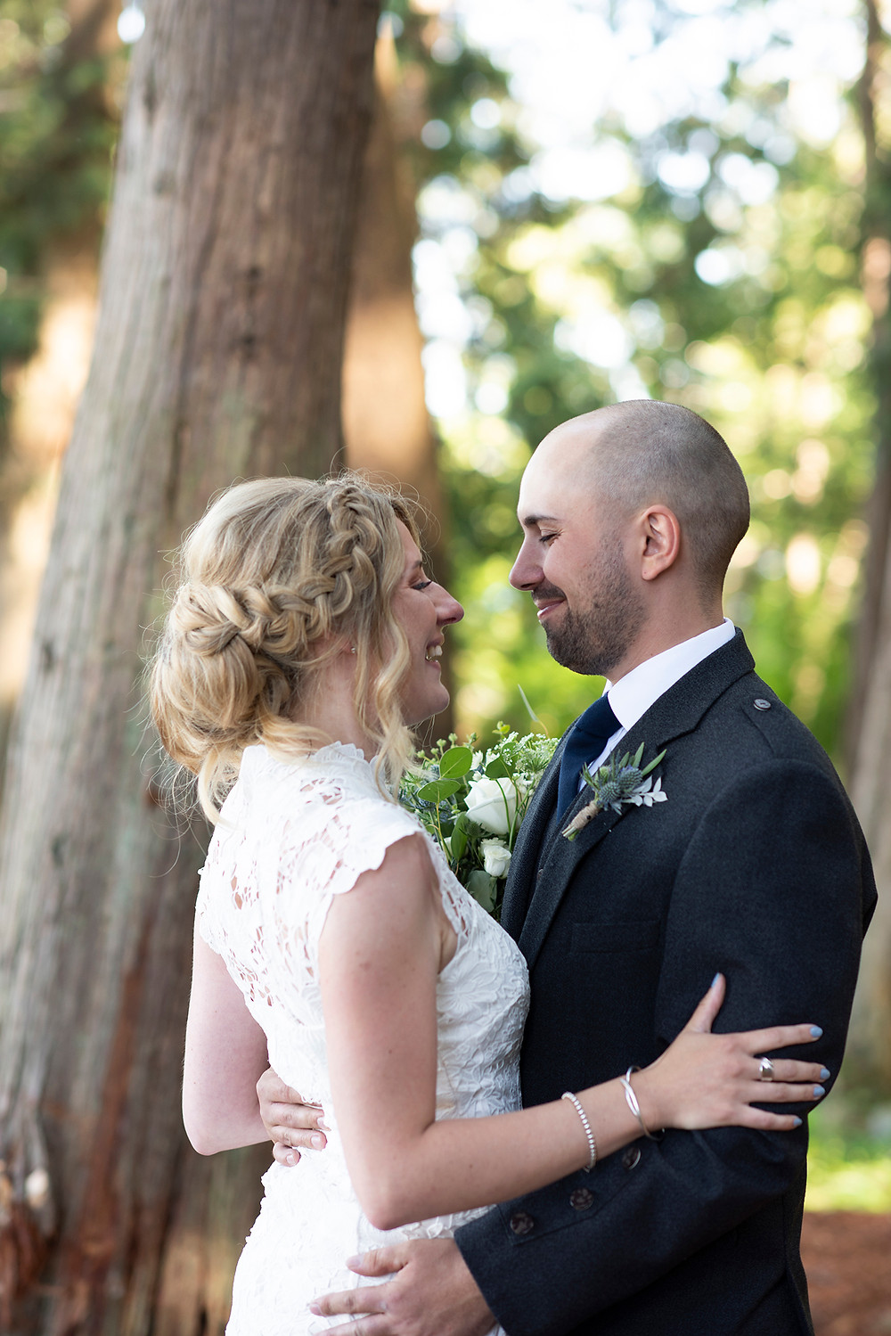 bride and groom embrace at their Sea Cider wedding in Victoria. Photographed by Kaitlyn Shea.