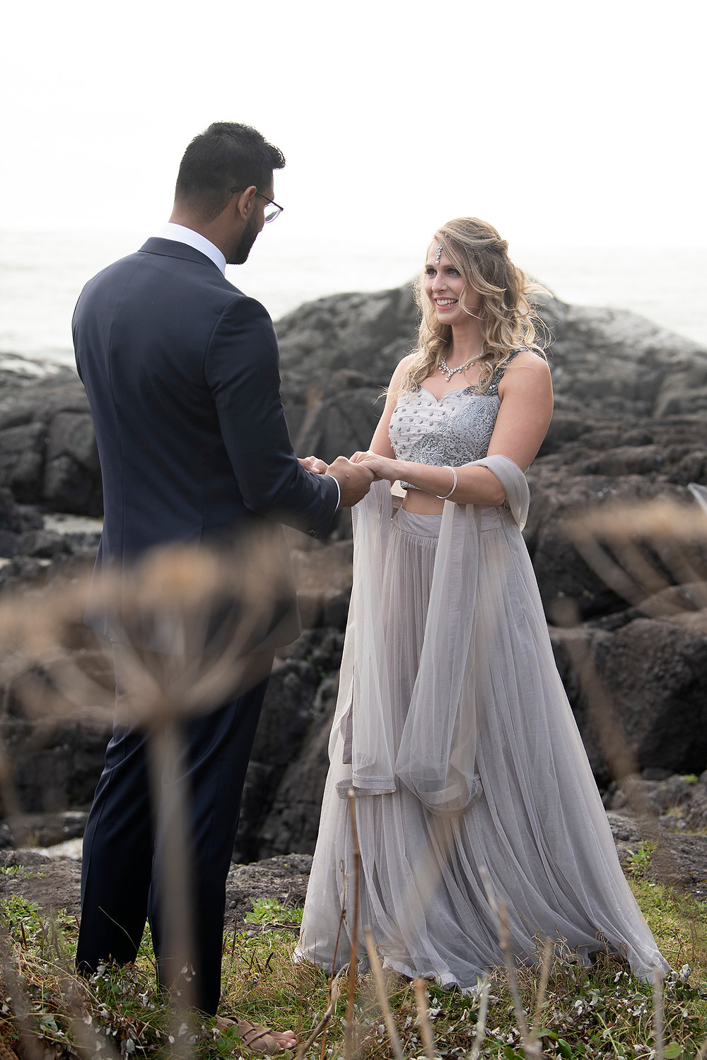 Bride looks at groom lovingly at their small wedding in Tofino. Photographed by Tofino wedding photographer Kaitlyn Shea.