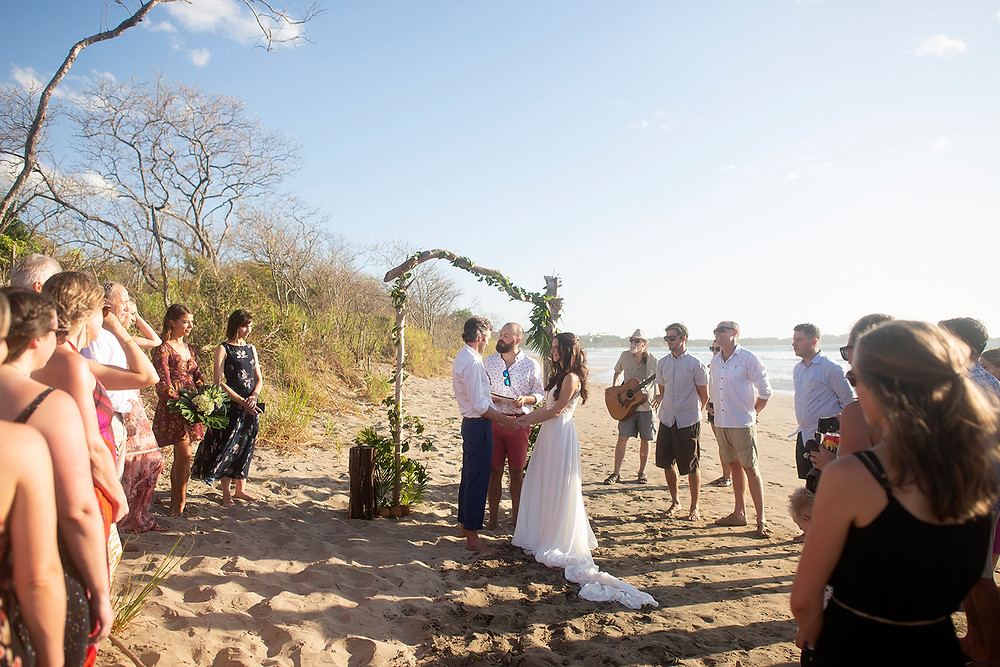 Beach wedding ceremony for a destination wedding in Playa Grande, Costa Rica. Photographed by Kaitlyn Shea.