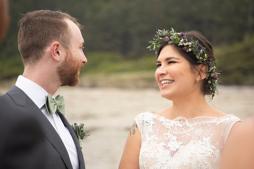 bride laughs at groom at Schooner Cove wedding Tofino. Photographed by Kaitlyn Shea