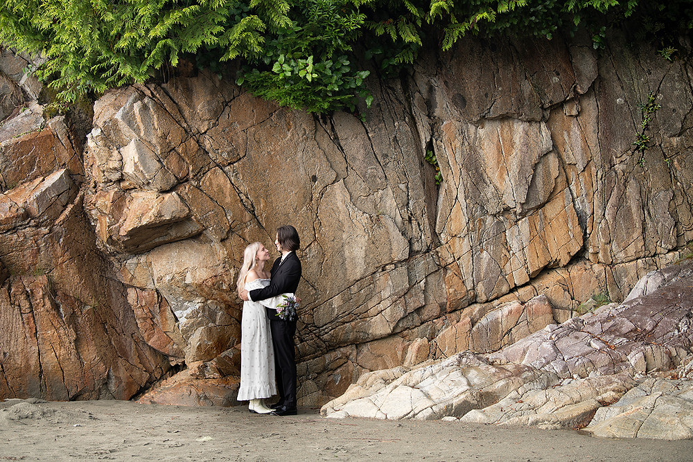 Couple embraces at their Tofino wedding at Tonquin Beach. photographed by Tofino wedding photographer Kaitlyn Shea.