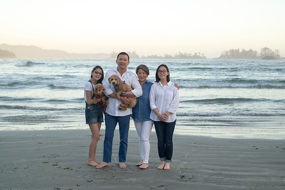 family standing together on the beach during their family pictures in Tofino | Photographed by Tofino photographer Kaitlyn Shea