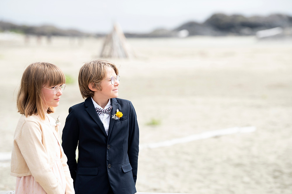 Kids watch as their parents get married on Long Beach in Tofino. Photographed by Kaitlyn Shea.
