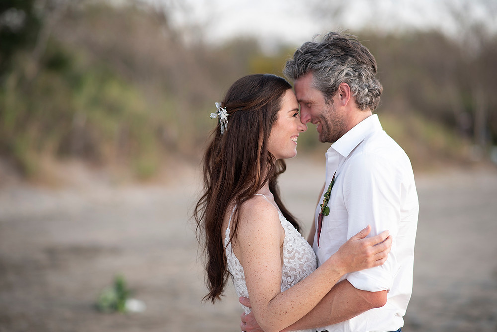 Happy couple at their wedding in Playa Grande, Costa Rica. Photographed by Kaitlyn Shea.