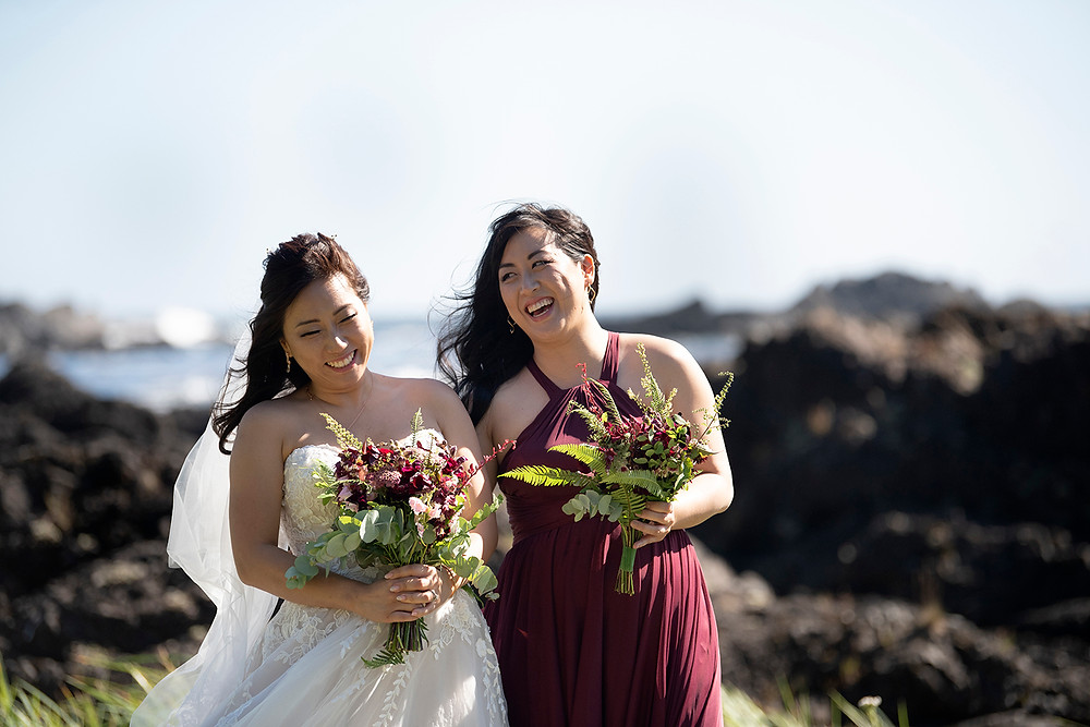 Bride and her sister laugh at her Ucluelet wedding at Black Rock Resort. Photographed by Ucluelet Photographer Kaitlyn Shea.