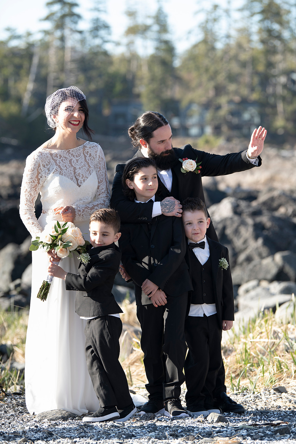 Family smiling in the sun at Elopement in Ucluelet. Photographed by Kaitlyn Shea.