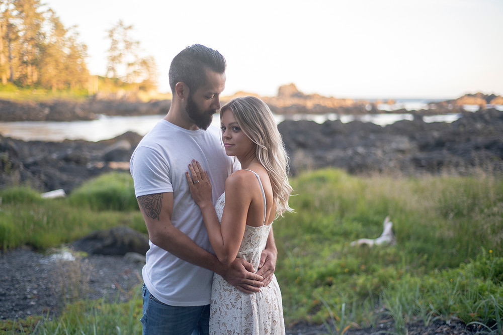 Man stares lovingly at his fiancé during their engagement photos in Ucluelet. photographed by Tofino photographer Kaitlyn Shea.