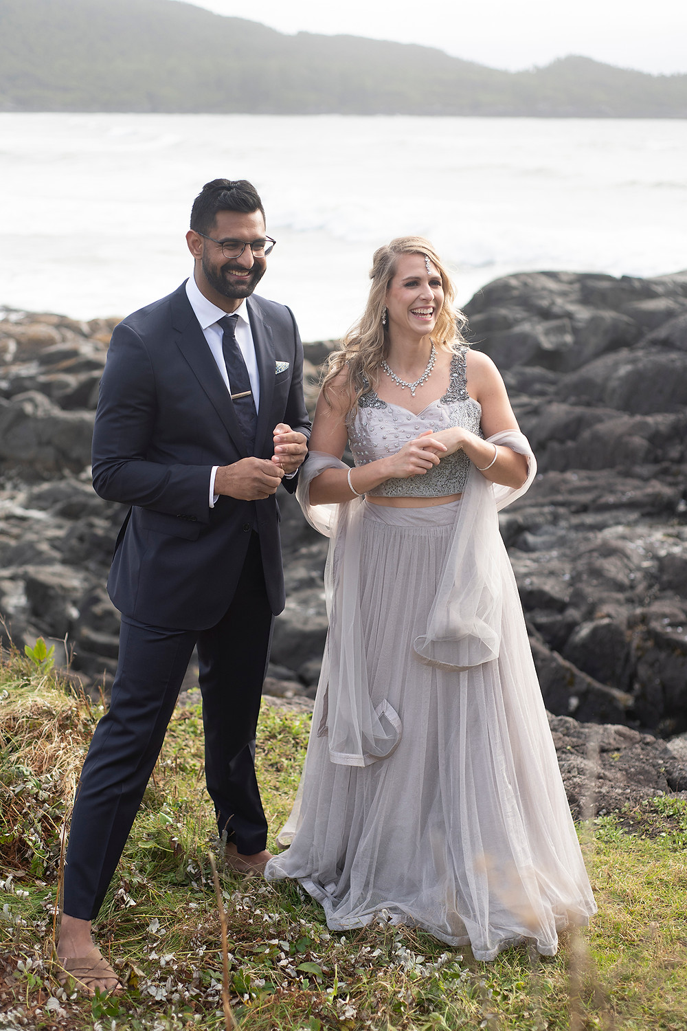 Bride and groom smile on pettinger point at their small wedding in Tofino. Photographed by Tofino wedding photographer Kaitlyn Shea.