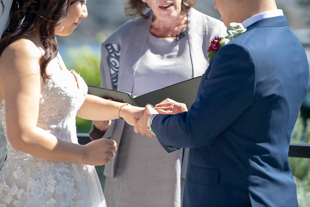 Groom puts wedding ring on bride's hand at their Ucluelet wedding at Black Rock Resort. Photographed by Ucluelet Photographer Kaitlyn Shea.