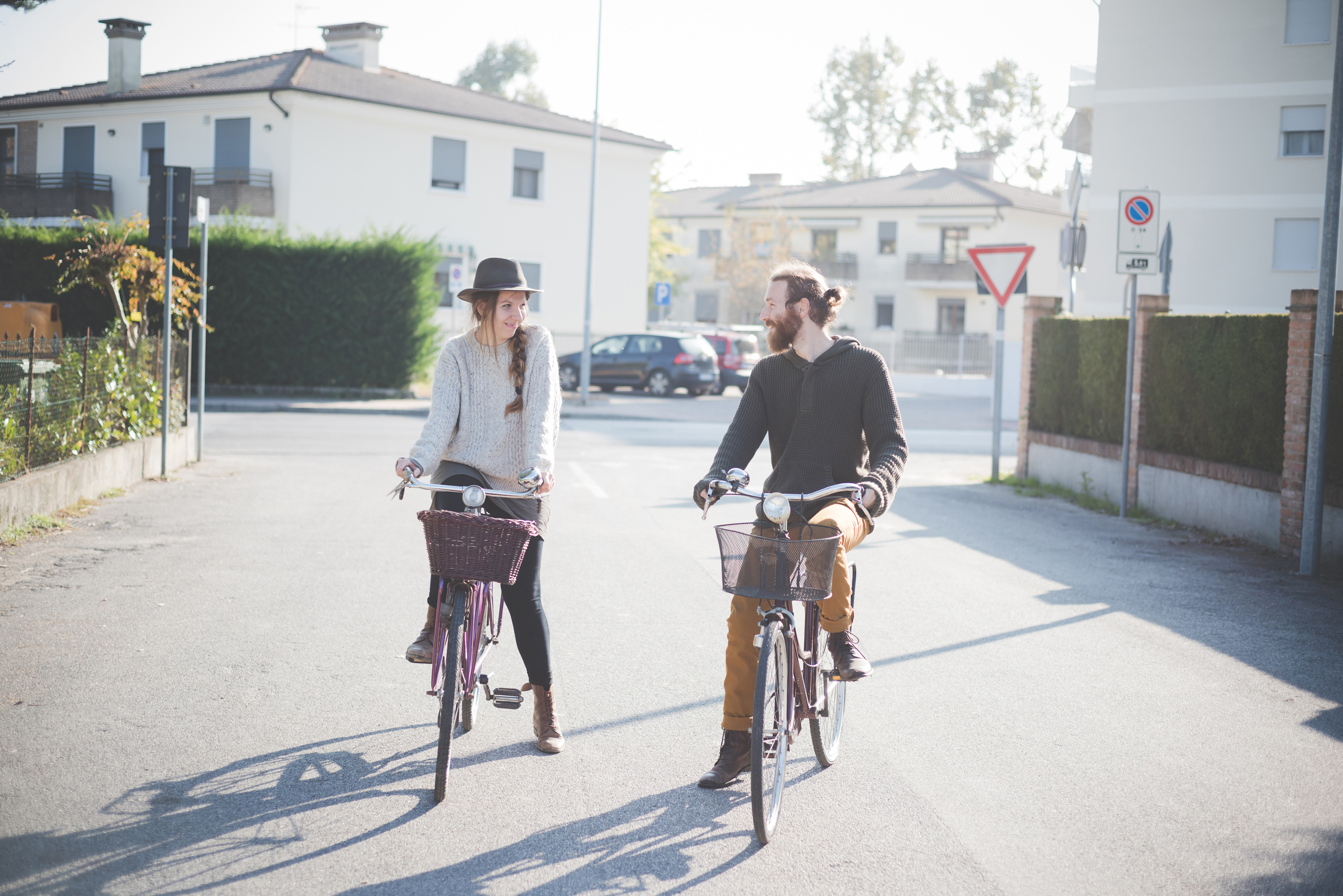 couple riding bicycles on street