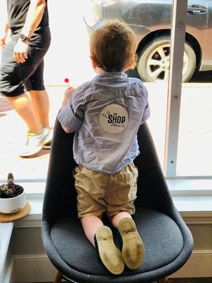 Boy at barbershop window