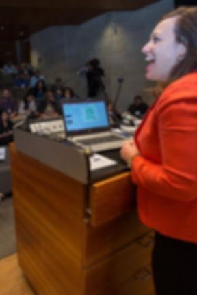 Maya speaking to crowd portrait.jpeg
